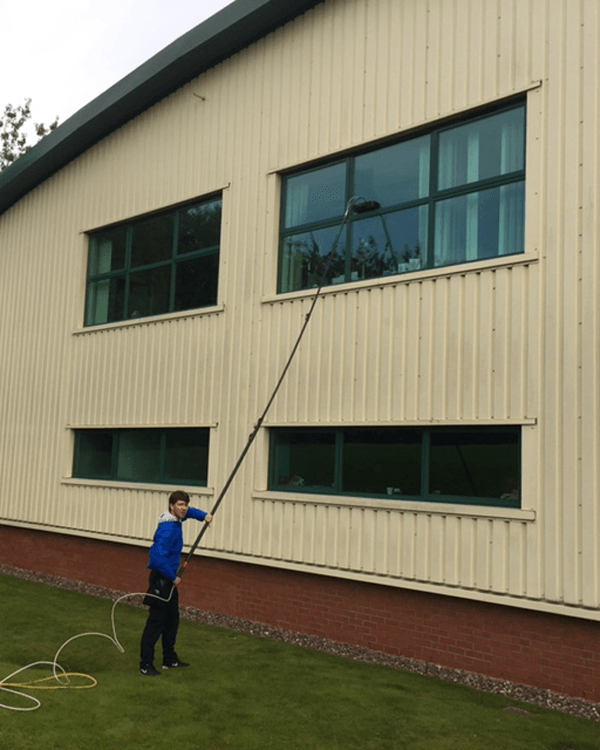 A member of staff cleans a high window in Edinburgh